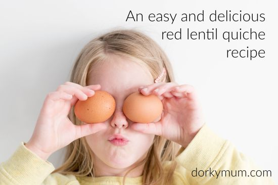A girl holding up two eggs with the slogan 'An easy and delicious Red lentil quiche recipe'