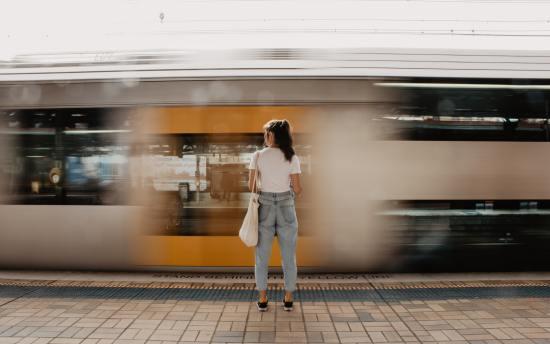 woman standing on railway platform