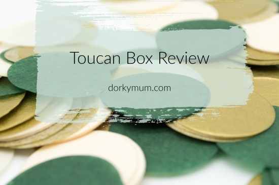 Text 'Toucan box review' on top of an image of green felt coaster