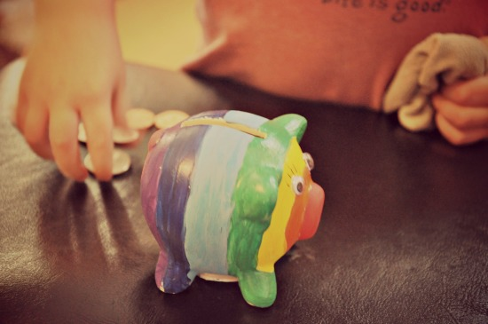 rainbow coloured Piggy Bank and coins