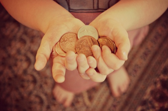 child's hands with coins