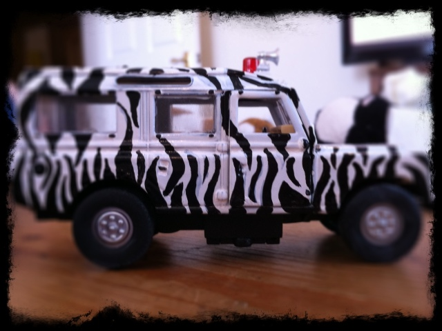 toy safari jeep with zebra stripes