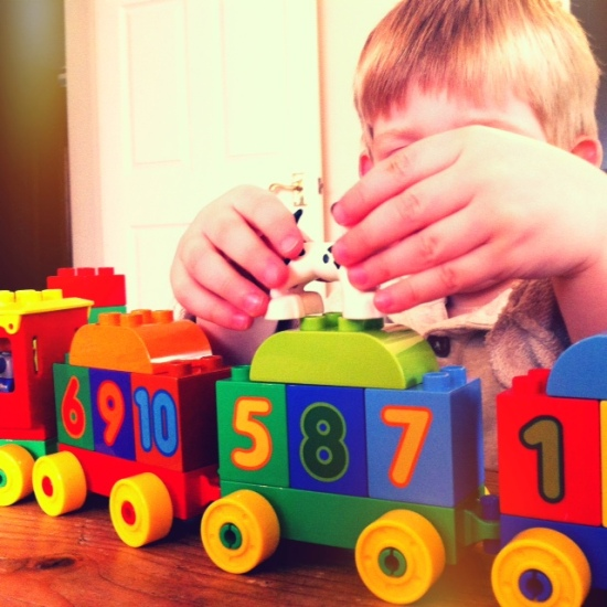 Young boy playing with the LEGO DUPLO Number Train
