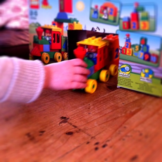 Young Boy playing with Lego Duplo Number Train