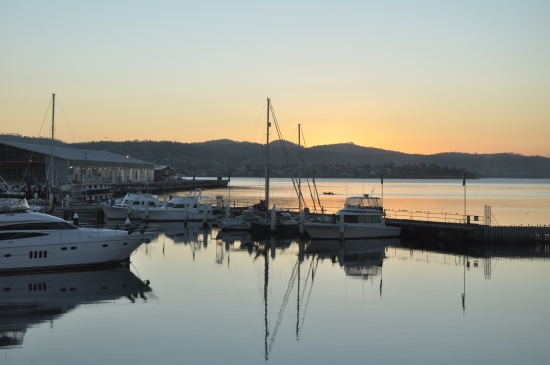 The sun setting over boats on the waterfront in Hobart, Tasmania