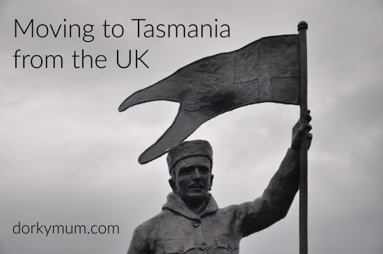 A statue of Louis Bernacchi at Hobart waterfront with the text 'Moving to Tasmania from the UK'