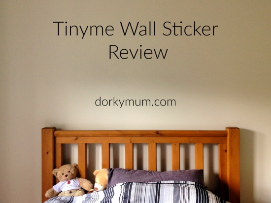 A blank bedroom wall with text 'Tinyme Wall Sticker Review'