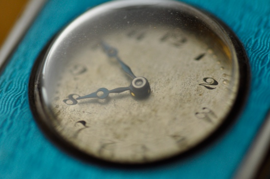 macro photography old enamel clock