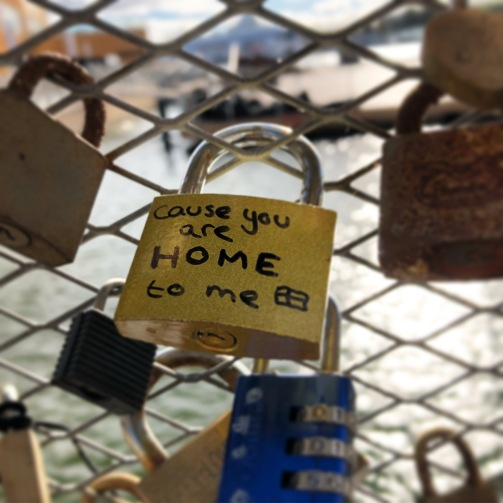 Love lock reading 'you are home to me' on bridge in Helsinki