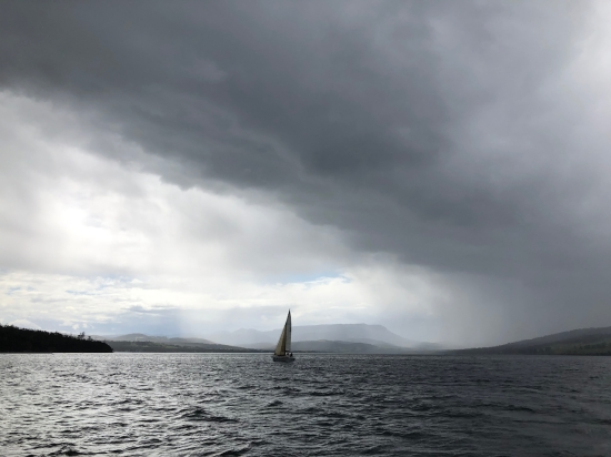 a yacht sailing on the River Derwent in Tasmania viewed from wooden ship SV Rhona H