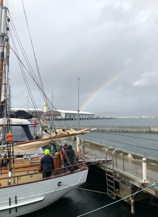 Rainbow at Hobart waterfront, old wooden ship SV Rhona H in foreground