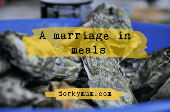 A bucket of raw oysters with the text 'a marriage in meals'