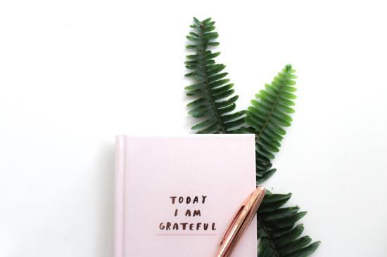 Flatlay image of daily gratitude journal